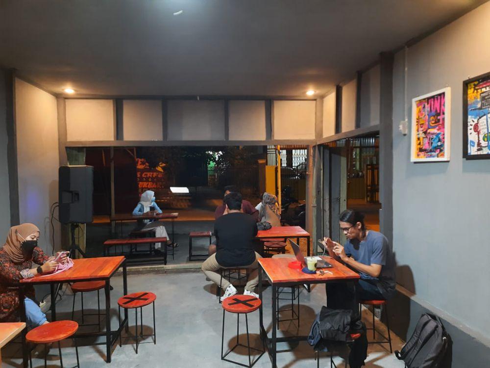 Grand Opening News Cafe yang terletak di Jalan Ki Maja, RT 20, Nomor 55, Simpang III Sipin, Kecamatan Kota Baru, Kota Jambi.